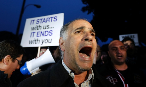 A protester shouts slogans during a rally by employees of Cyprus Popular Bank outside the parliament in Nicosia March 21, 2013.