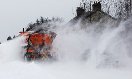 A snow plough clears the A6 road near Buxton