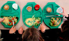 Children enjoying their school meals in Cambridgeshire