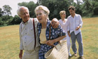 Elderly couple walking with young couple behind