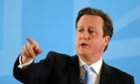 David Cameron delivers a speech on immigration at in Ipswich, eastern England on March 25, 2013.