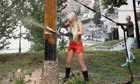 Femen activist cuts down a cross, Kiev