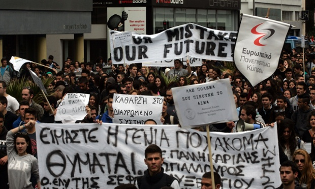 Students protest against austerity measures in front of Cypriot Presidential House on March 26, in Nicosia, Cyprus.
