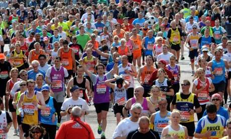 Competitors head to the finish line during the 32nd Virgin London Marathon in London.