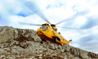 An RAF Sea King helicopter during a training exercise at Holyhead Mountain