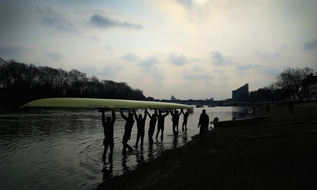 Rather you than me! Oxford's Isis crew lift their boat into the water during a training outing on The River Thames in London, England. The 159th University Boat Race will take place on Sunday  from Putney to Mortlake.