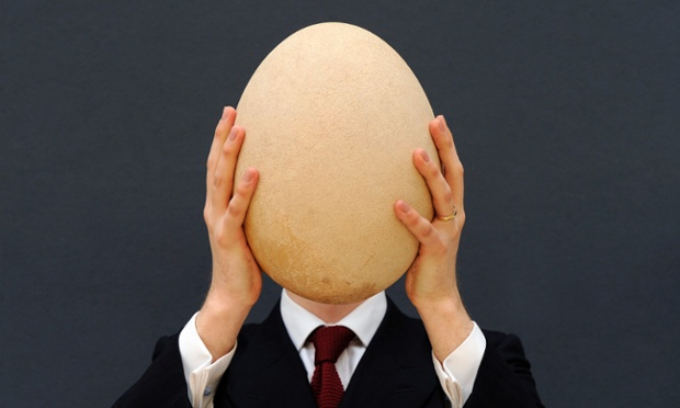 That's gotta hurt! James Hyslop, Scientific Specialist for Christie's auction house, holds up an extremely rare and complete sub-fossilised elephant bird egg at in London. The egg which is over a hundred times larger than an average chicken egg is native to Madagascar. The poor bird that laid it was the largest bird ever to have lived. Resembling a heavily built ostrich it grew to over three meters in height. Its thought to have been hunted to extinction in Madagascar between the 14th and 17th centuries. Photograph: Andy Rain/EPA