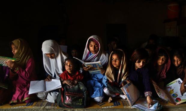 Pakistani schoolchildren attend their daily classes in a makeshift school set in a clay house on the outskirts of Islamabad. Threats from militant groups is one of many obstacles Pakistani girls and teachers face in getting and providing an education. Others include rampant poverty, harassment and the government's failure to prioritize education spending. Both sexes have suffered from the lack of funding, but girls, who have lower rates of literacy and school attendance, are in a particularly perilous position.