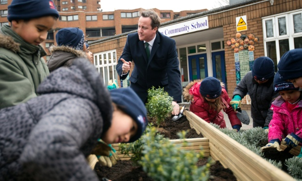 There appears to be a lot of horticultural photocalls going on today. Britain's Prime Minister David Cameron helps school children plant box shrubs, during a visit to Ashburnham Community school, where he attended the planting of the 6 millionth tree by the charity The Woodland Trust, in London.