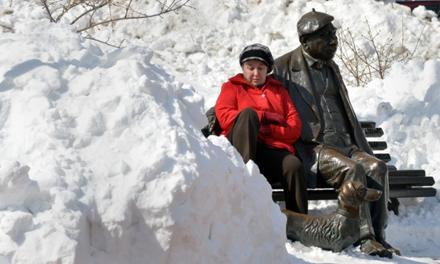 What's the weather like outside? No. 5. It's Kiev, Ukraine and it's -6C. A woman tries to warm herself in the sun as she sits at the monument for Ukrainian popular actor Mykola Yakovchenko.