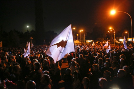 Protesters take part in an anti-bailout rally outside the Presidential Palace in Nicosia March 27, 2013.