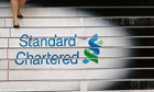 Standard Chartered logo on headquarters steps