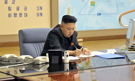 Kim Jong Un attending a meeting with top military officials