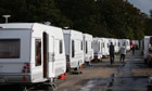 Caravans line an access road to Dale Farm travellers site, near Basildon, England