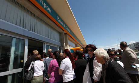 Long line of customers crowding the bank entrance.
