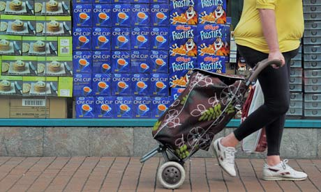 woman pulls her shopping basket