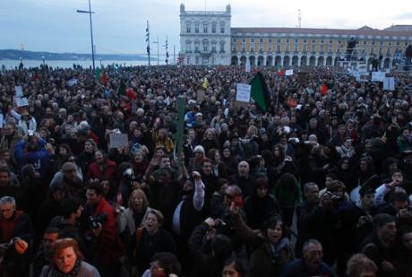 Demonstrators crowd Lisbon's Comerio square.