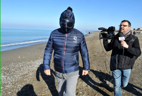 Italian comedian, blogger and political leader of the Five Stars Movement (M5S) Beppe Grillo is questioned as he runs on the beach on March 3, 2013 in Marina di Bibbona, near Livorno, Italy.