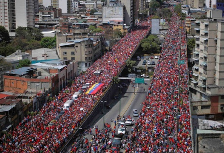 The coffin of Venezuela's late President Hugo Chavez is driven through the streets of Caracas after leaving the military hospital where he died of cancer, in Caracas, March 6, 2013.
