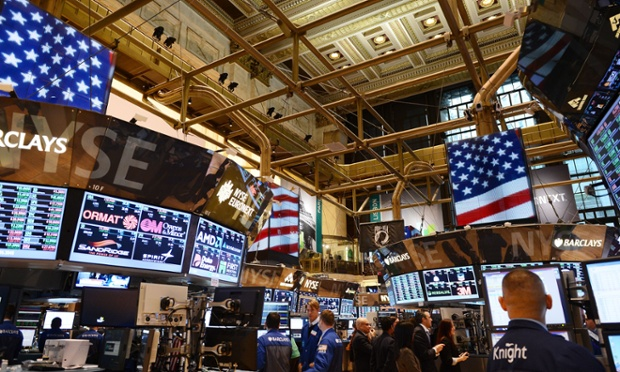 Traders looked at their monitors on the floor of the New York stock exchange.