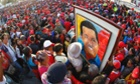 Supporters of Venezuela's late President Hugo Chavez wait for a chance to view his body at the military academy in Caracas where Chavez will be embalmed and put on display after a state funeral.