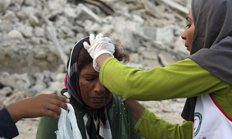 An Iranian woman receives medical treatment after an earthquake struck the country's south
