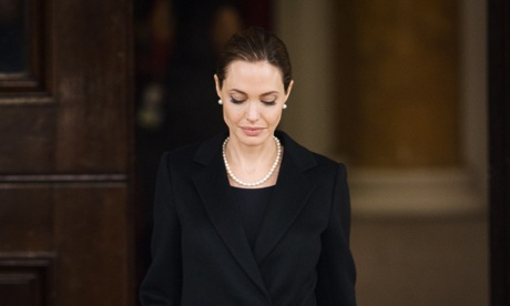 Actor and humanitarian campaigner Angelina Jolie leaves Lancaster House in central London after speaking during an announcement of funding to address conflict sexual violence on the sidelines of the G8 Foreign Ministers meeting. The G8 has pledged £10 million in funding to support efforts to tackle sexual violence in conflict and violence against women and girls.
