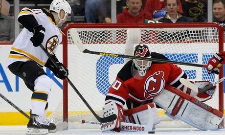 Boston Bruins center Gregory Campbell scores past New Jersey Devils goalie Martin Brodeur