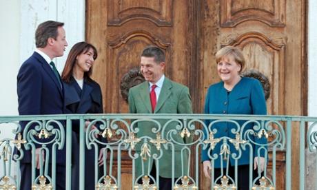 German Chancellor Angela Merkel and her husband Joachim Sauer welcome David and Samantha Cameron.