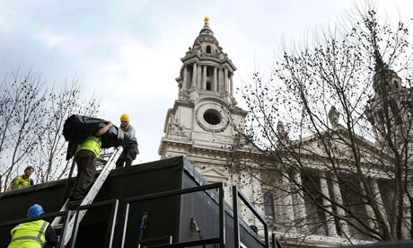 Workmen build a stand for the media ahead of Margaret Thatcher's funeral ceremony