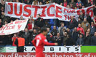 Liverpool fans hold up banners callin