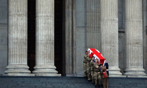 British forces' officers carry a Union flag-draped coffin outside St Paul's Cathedral in central London early today during the rehearsal for the  funeral of Lady Thatcher.