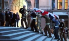 Bearer Party from the three military services carry a coffin up the steps of St Paul's Cathedral during a rehearsal for the ceremonial funeral of Lady Thatcher.