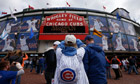 A fan takes pictures of Wrigley Field