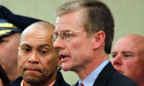 Massachusetts governor Deval Patrick listens as FBI special agent Richard DesLauriers briefs reporters during a news conference.