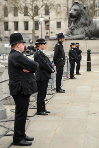 Police and lions wait for the crowds to gather in Trafalgar Square. Lady Thatcher's coffin will travel across the square in a hearse before being transferred to the gun carriage in the Strand.