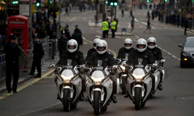 More police hardware: motorbikes ride along Whitehall.