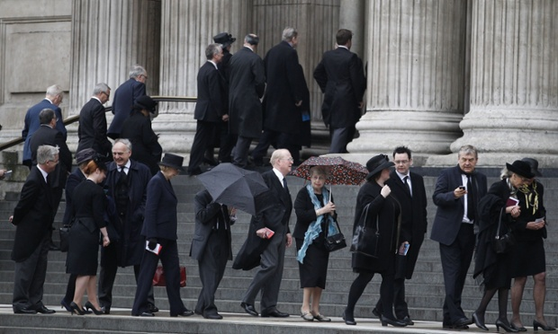 Guests make their way up the steps of St Paul's Cathedral for the funeral service.