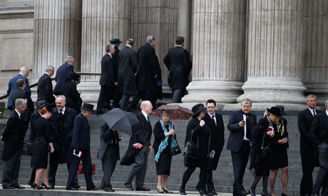 Mourners make their way up the steps of St Paul's Cathedral