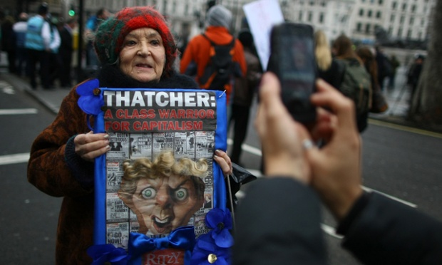 Home-made signs appear to be popping up everywhere. Here Mary MacMillan makes her anti-Thatcher feelings known in Trafalgar Square.