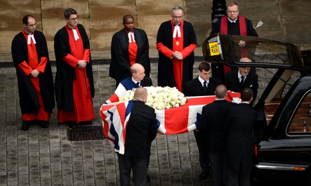 The coffin leaves the chapel of St Mary Undercroft at the Houses of Parliament.