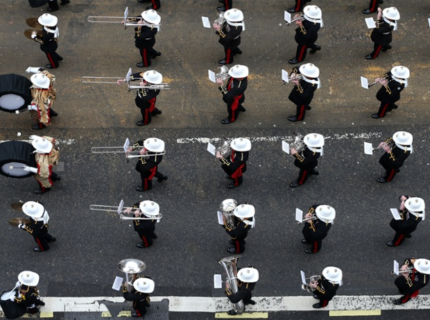 A military band march past.