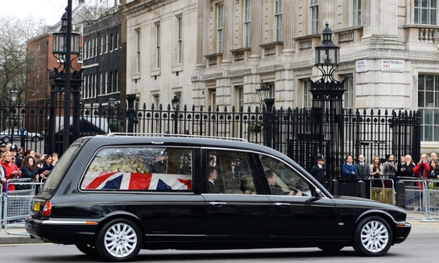The hearse carrying the coffin of Lady Thatcher passes the gates of Downing Street.