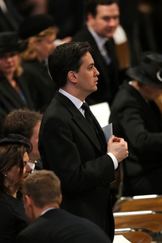 The Labour party leader, Ed Miliband, stands in St Paul's Cathedral ahead of the funeral service. Isn't that George Osborne in the background?