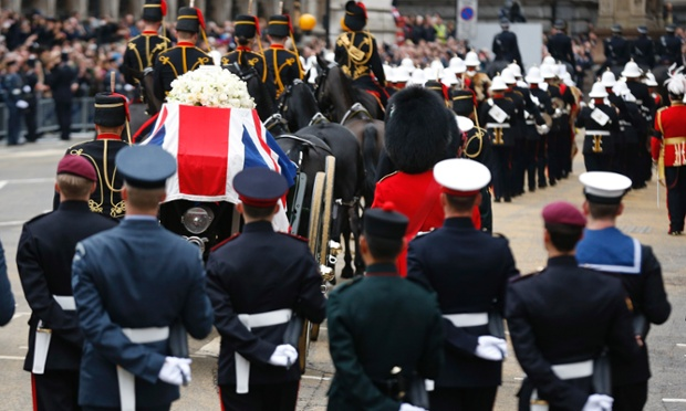 The Union flag draped coffin is carried on the gun carriage drawn by the King's Troop Royal Artillery down Fleet Street.