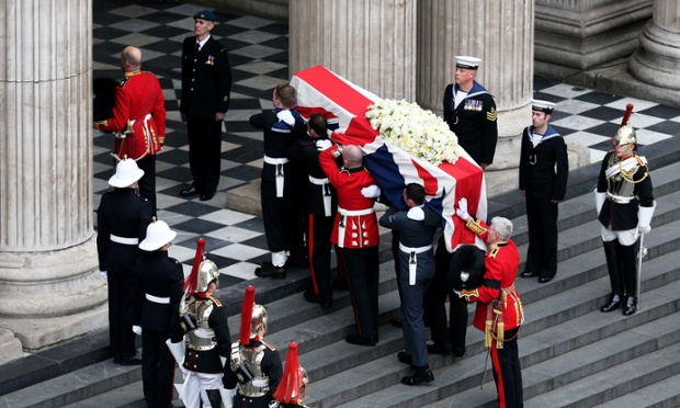 Members of the Armed Services carry the coffin up the steps of St Paul's Cathedral.