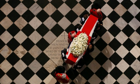 The coffin of former British prime minister Margaret Thatcher is carried by the Bearer Party against the background of the Cathedral floor.