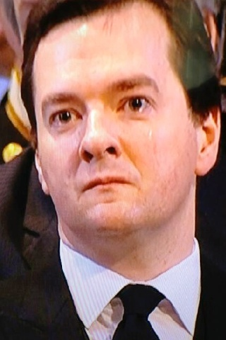 Chancellor George Osborne sheds a tear during the service.