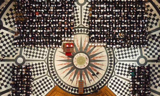 Taken earlier, an overhead view of the Cathedral interior showing the special seats and rug for the Queen and Price Philip in the front row and the empty plinth awaiting the coffin.