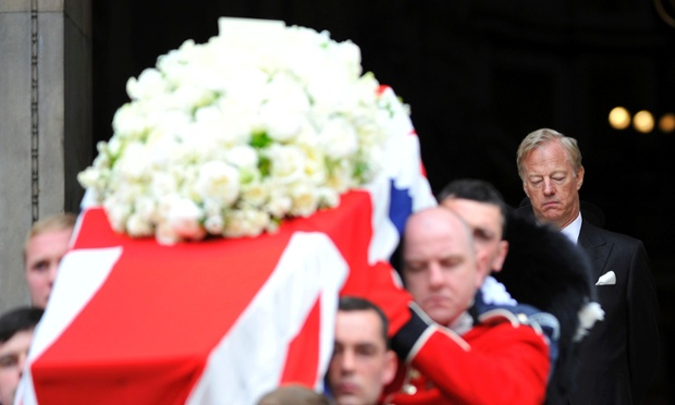 Mark Thatcher walks behind the coffin of his mother as it leaves St Paul's Cathedral.